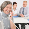 Senior business woman on the phone — Stock Photo