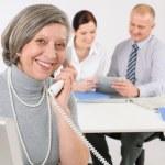 Senior business woman on the phone — Stock Photo