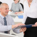 Professional mature businessman office secretary — Stock Photo