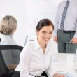 Giving presentation young woman during meeting — Stock Photo #11375306