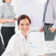 Giving presentation young woman during meeting — Stock Photo #11375314