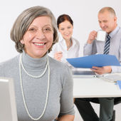 Business team senior manager woman with colleagues — Stock Photo