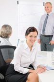 Giving presentation young woman during meeting — Stock Photo