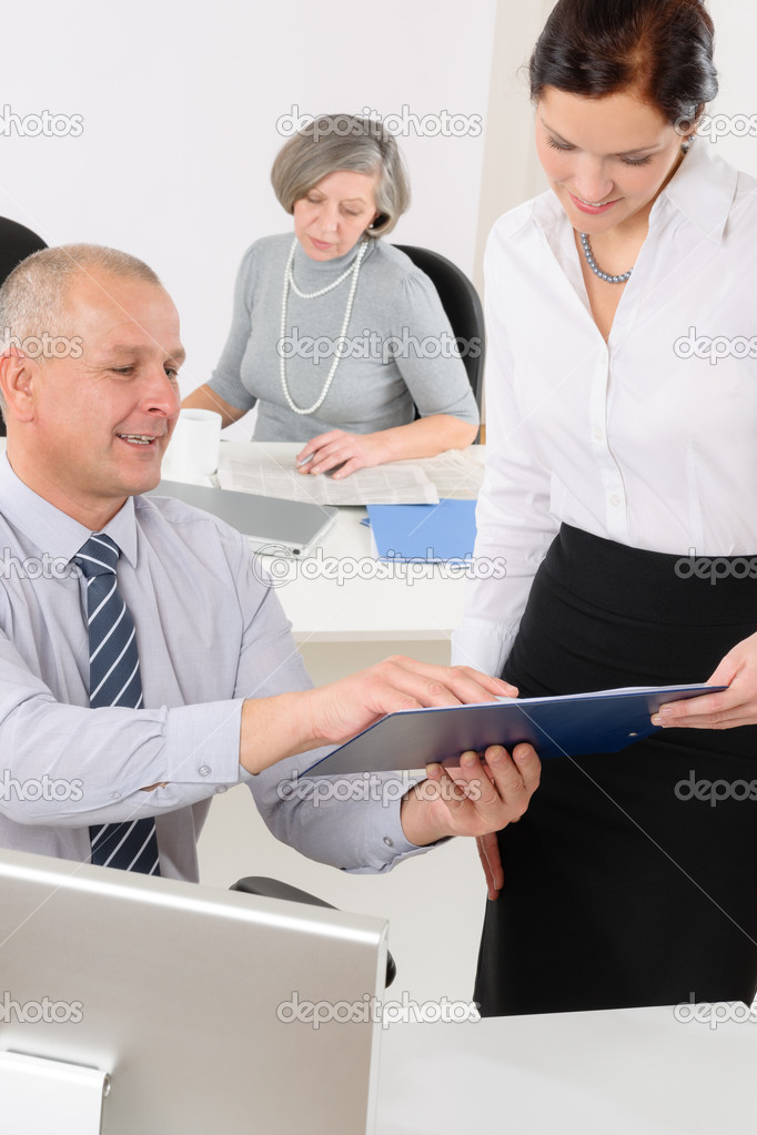 Professional mature businessman in office with attractive secretary — Stock Photo #11375254