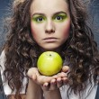 Portrait of girl with green apple — Stock Photo #11176898