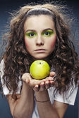 Portrait of girl with green apple — Stock Photo