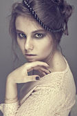 Portrait of a girl with a romantic hairstyle — Stock Photo