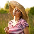 Portrait of a beautiful woman in a countryside — Stock Photo