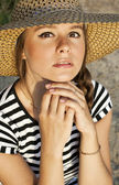 Closeup portrait of a cute young woman wearing hat — Stock Photo