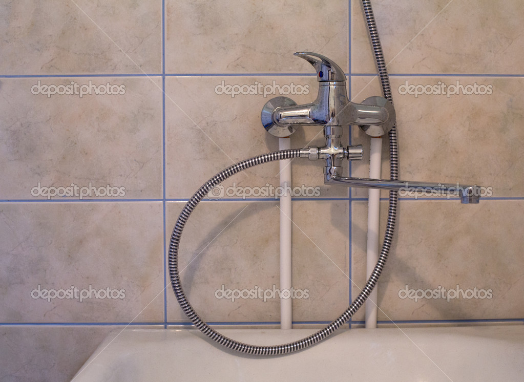 Crome shower faucet turned to the right side — Stock Photo #11476769
