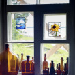 Stock Photo: Bottles standing on windowsill in one line