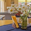 Daisys are placed in vase in restaurant — Stock Photo #11640060
