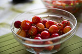 Pile of cherries palced in glasses bowl — Stock Photo