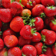 Zoomed fresh strawberries places in metal bowl — Stock Photo #11776852