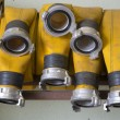 Stock Photo: Zoomed yellow firehose are hanging in warehouse