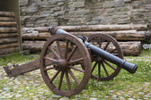 Ancient cannon maded from cast iron — Stock Photo