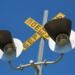Lights which warning car drivers about train — Stock Photo