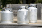 Three different sizes cans on scaffold — Stock Photo