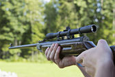 Fast targeting with hand weapon through sight — Stock Photo