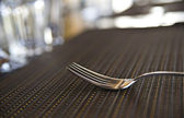 Lonely chromed fork on kitche table — Stock Photo