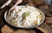 Bred and porridge in dish — Stock Photo
