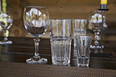 Empty glass goblets stand on table — Stock Photo