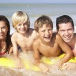 Young family pose on beach - Stock Photo