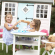 Two young girls play outdoors — Stock Photo #11878859