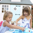 Two young girls play outdoors — Stock Photo #11878864
