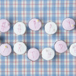 Cupcakes spell out happy birthday - Stock Photo