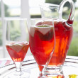 Постер, плакат: Fruit drink in a decanter and glasses