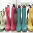 A display of colorful rain boots — Stok fotoğraf
