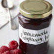 A still life of raspberry jam in jar — Stockfoto
