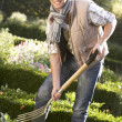 Young man working in garden - 