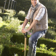 Young man working in garden — Stock Photo #11878973