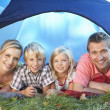 Young family poses in tent — Stockfoto