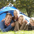 Stock Photo: Young family poses outside of tent