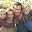 Young family pose in park — Stock Photo #11879061