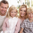Young family pose together — Stock Photo