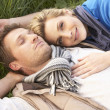 Young couple lying together on grass — Stock Photo #11879284