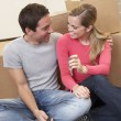 Young couple on moving day sitting with cardboard boxes - Stockfoto