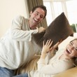 Young couple having fun laughing on sofa — Stock Photo