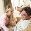 Young father with girl having fun on sofa — Photo