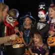 Happy Halloween party with children trick or treating — Stock Photo