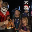 Stock Photo: Happy Halloween party with children trick or treating