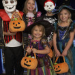Happy Halloween party with children trick or treating — Stockfoto