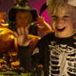 Halloween party with children wearing scaring costumes — Stock Photo #11879547