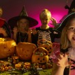 Halloween party with children wearing scaring costumes - Stock Photo