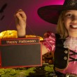 Stock Photo: Halloween party with a child holding sign in hand