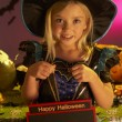 Stock Photo: Halloween party with a child holding sign